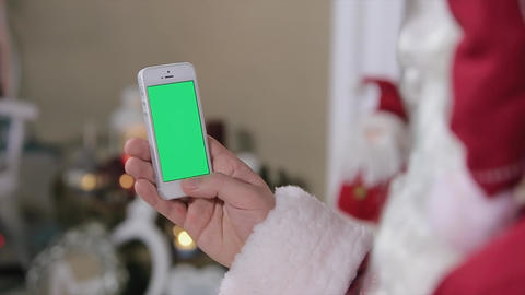 Santa Claus Using Phone With Green Screen In Home. Smartphone With Green Screen  stock footage