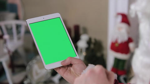 Santa Claus Using Digital Tablet Green Screen. Tablet With Green Screen In Verti stock footage