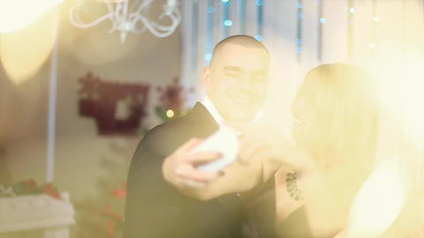 Woman in evening black dress makes selfie on the phone the man in the black suit Footage