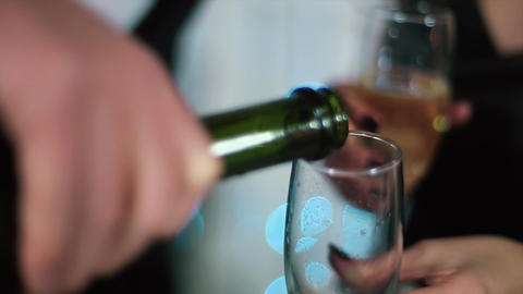The Man in The Black Suit Pours Out of The bottle, the woman in black evening dr Footage