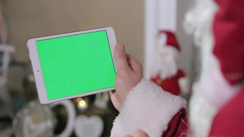 Santa Claus Work On Digital Tablet Green Screen. Tablet With Green Screen In Lan stock footage