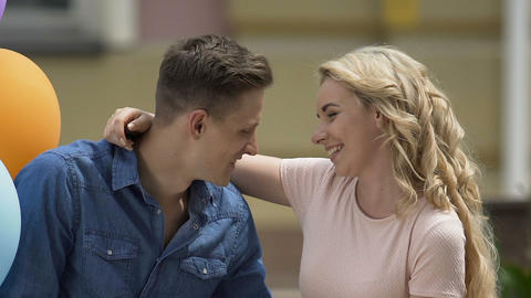 Cheerful blond female hugging and kissing tenderly her boyfriend, romance Footage
