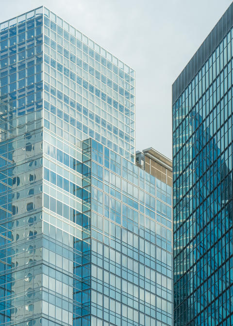 Business buildings with reflection on glass Photo