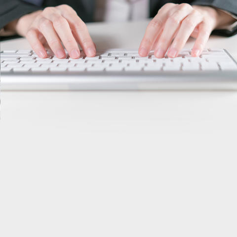 Business woman typing on keyboard computer on white desk with copyspace Photo