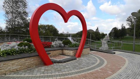 Wedding arch in the form of red heart. Wedding…, Live Action
