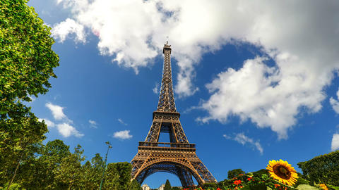 Clouds passing over world famous Eiffel tower in time lapse effect Live Action