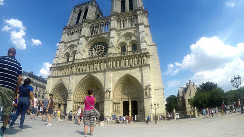 Paris, France - 06 July, 2018: Tourists by world famous Notre Dame Cathedral Live Action