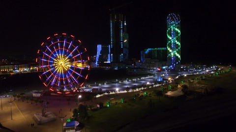 Stunning view of panoramic wheel and Alphabetic tower illumination at night Live Action