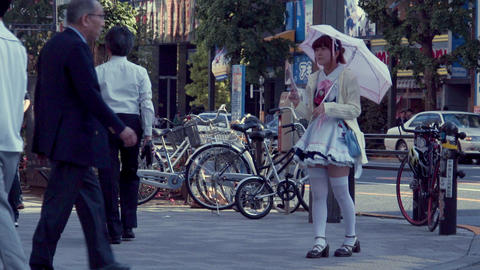 Woman solicits customers to a maid cafe in Akihabara GIF
