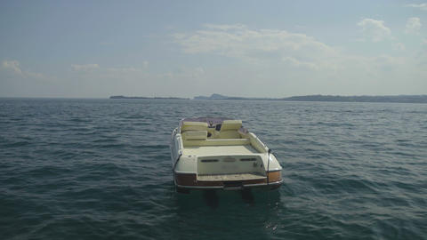 Beautiful white motorboat floating on lake Garda in Italy, journey, vacations Live Action