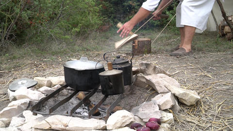 Camp in the forest. Pans on the fire Live Action