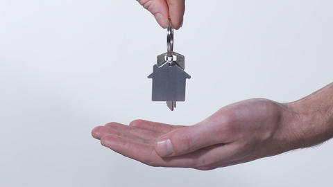 Broker putting key from new house in buyer's hand, purchase of real estate Live Action