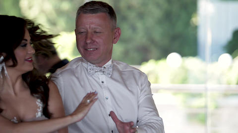 Happy groom dance and look to the he's lovely Bride while dancing Footage