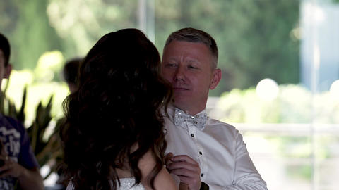 Happy groom dance and look to the he's lovely Bride while... Stock Video Footage