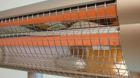 Heat lamp gradually increasing temperature, electromagnetic radiation emission Live Action