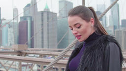 Young attractive girl walking on a bridge Manhattan View New York 4K Footage