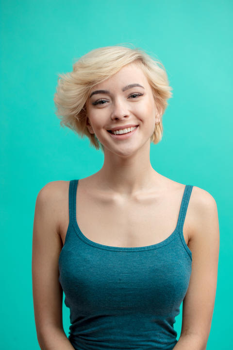 sexy girl with short fair hair with positive expression フォト