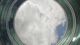 Cloudscape Through Round Building Facade Time-lapse Footage
