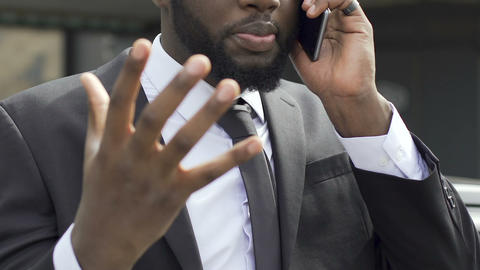 Businessman having phone conversation, getting mad about bad news, stressful job Footage