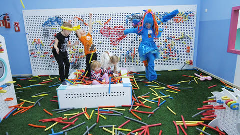 slow motion children play with colored foam rubber sticks in playroom 영상물