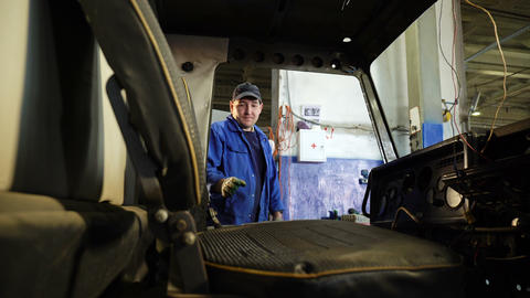 technician takes off chair in repaired truck driver cabin 영상물
