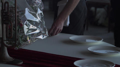 A banquet hall employee rubs his wine glasses Live Action