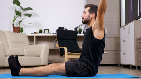 Man stretches and does different yoga poses Footage
