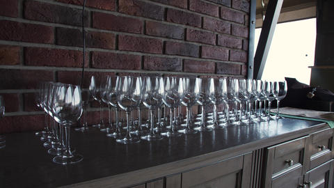 Empty wine glasses stand in a row at a banquet table indoors Stock Video Footage