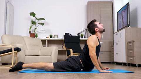 Young fit man practicing yoga and doing different poses Footage