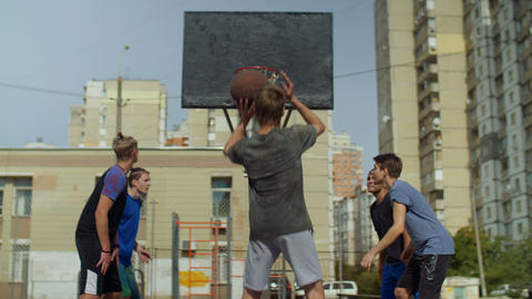 Streetball player taking a free throw on court Live Action