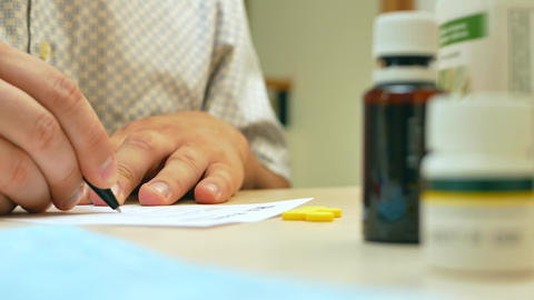 Doctor hand writing rx prescription Footage