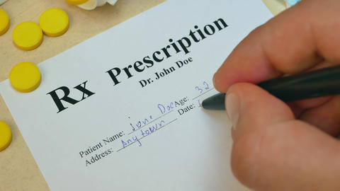 Healthcare professional doctor writing prescription for tablet pills or drugs Footage