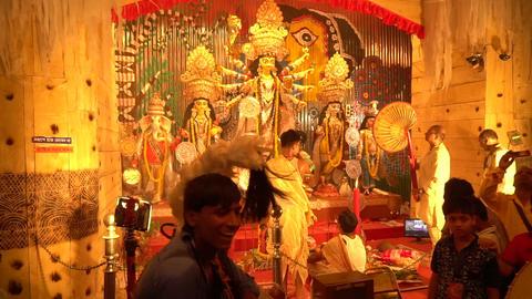 Priest worshipping Goddess Durga, Durga Puja festival celebration Live Action