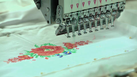 Automated Embroidery Thread on Fabric Machine Embroidery on Factory Footage