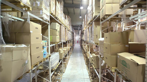 Camera Cranes Up On Shelves Of Cardboard Boxes Inside A Storage Warehouse stock footage