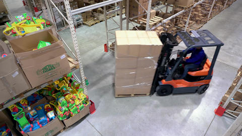 Loading Boxes in Warehouse, Forklift Rides Composition Returns to Right Footage