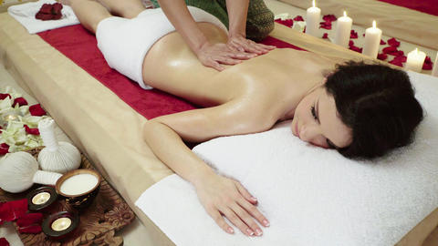 Brunette Client Receiving Body Massage at Spa Club Footage