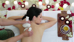 Woman in Spa Resort Massage Aromatic Herbs Bags Footage