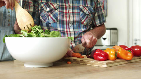 Preparation of a green salad in a salad bowl Live Action