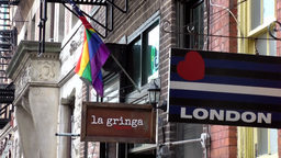 New York City 744 Christopher Street advertising signs and rainbow flag Footage