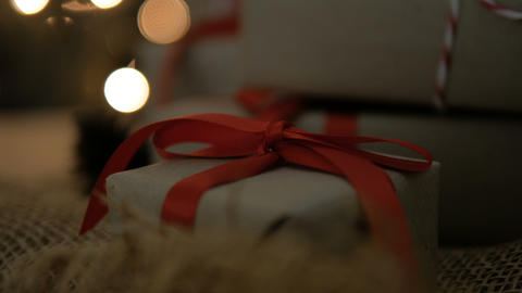 Christmas gift boxes with red ribbon against glow bokeh lights background 영상물