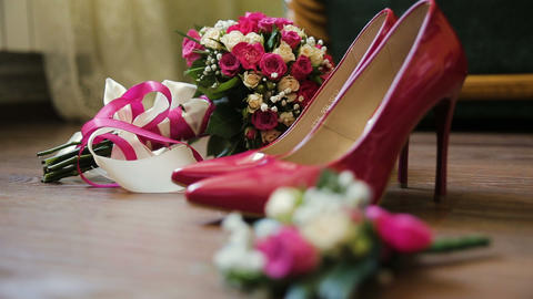 Luxury Pink Laced Bridal Wedding Shoes. Bouquet With Pink Rose On Brown Bckgrnd Footage