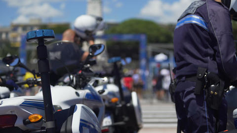 Traffic policemen maintaining public order during mass event in big city Footage