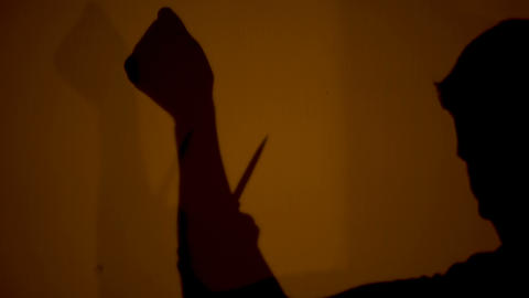 Mystical shadow of person letting himself blood, witchcraft rituals, sacrifice Live Action