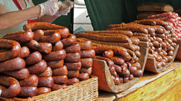 Farmers market. Sausages for sale Footage