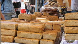 Loaves of bread at open air food market. People are buying bread Footage