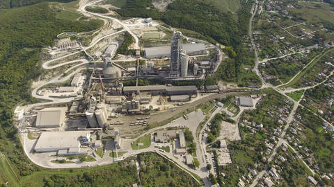 Verkhnebakansky cement plant, top view. Factory for the production and Live Action