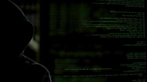 Faceless dark man on codes background stealing personal data, launching malware Footage