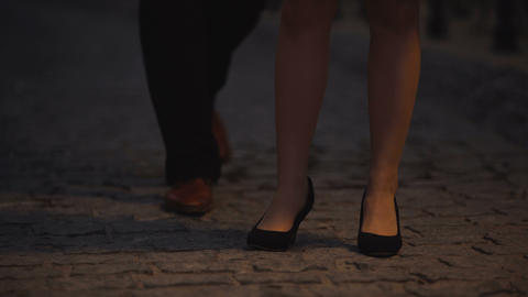 Woman waiting for her date impatiently, old city stone-block pavement, romance Footage