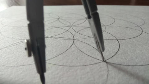 compasses draw a circle on a piece of paper Footage